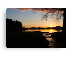 The Final Moments of a Sunset Over Water Canvas Print