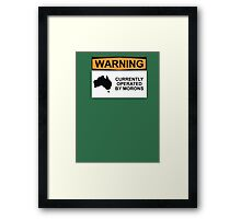 WARNING: CURRENTLY OPERATED BY MORONS Framed Print