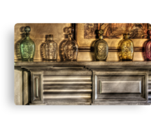Mantle with a collection of bottles Canvas Print