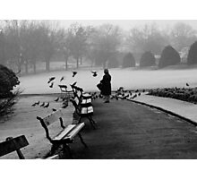 Shy woman feeding pigeons Photographic Print