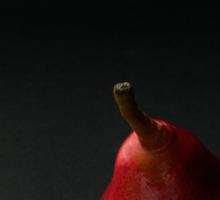 Red pear over dark background Sticker