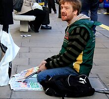 Big issue seller by Roxy J