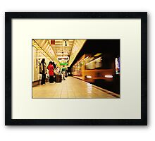 The Metro Now Arriving..... Framed Print