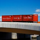 Red Containers on a Yellow Bridge by Mark Higgins