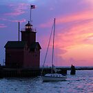 Holland Harbor Lighthouse At Sunset by Brion Marcum
