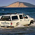 Driving around Mudlo Rocks at Rainbow Beach by Darren Stones