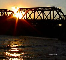 The Truss Bridge Sunset by Madeline M  Allen