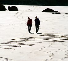COUPLE WALKING ON WELSH BEACH by kfbphoto