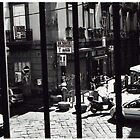 Bar through bars - Naples 2007 by Adam Irving