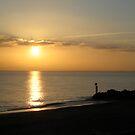 Sunset on the Beach by Faith Barker Photography