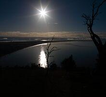 Dark Sunlight, Seven Mile Beach, Tasmania by David Jamrozik