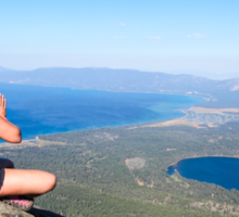 Woman meditates on a rock on mount Tallac  Sticker