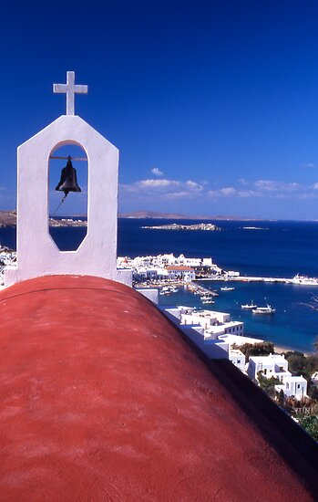 Greece. Cyclades Islands. Mykonos. Greek Orthodox Church and the harbour in Mykonos Town. by Steve Outram