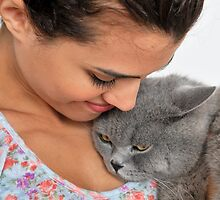 fond female owner with her British Shorthair cat by PhotoStock-Isra