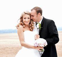 Bride and groom on beach 2 by nayamina