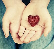 Holding a heart in hands by Ilze Lucero