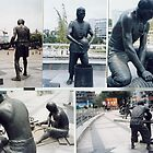 Photographs of bronze statues of Chinese Ceramic pottery workers.  by John Meadows
