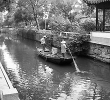 Boating on a Chinese canal by Julien Bertrand