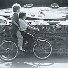 Two Boys on a Bicycle by Mike Paget
