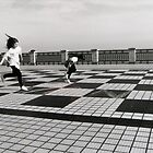 Two girls Play Hopscotch by Mike Paget