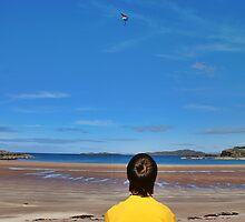 Flying A Kite In The Wind With Brother In Foreground by Joel Kempson