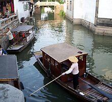 Sampan in canal by cometkatt