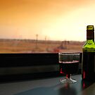 Red Wine on a Sunset Bound Train by Karin  Hildebrand Lau