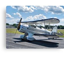 Biplane at the Bay Canvas Print