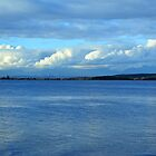 Crescent beach in White Rock, BC. Landscape photography of sea, blue sky and white clouds. by naturematters