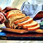 Grandma Slicing Bread by Susan Savad