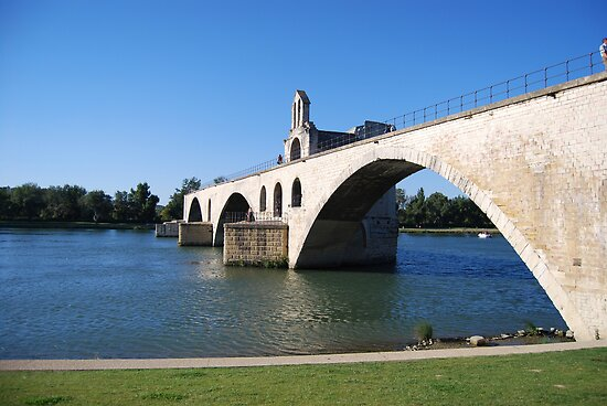 Bridge over Rhone river by windmill