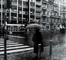 OLD LADY CROSSING THE STREET AT 8:00 AM AT MILANO by Alvaro Sánchez