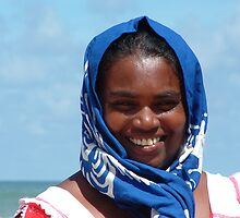 sri lankan seller on the beach by Marie Tixier-Brennan