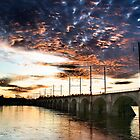 Railroad bridge at sunset by Jeff  Wiles