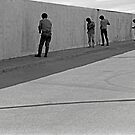 MEN AND WALL LA LINEA SPAIN by kfbphoto