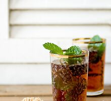 Glass of mint tea with sesame cookie, close-up  by PhotoStock-Isra
