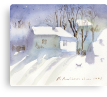Village house covered in snow Canvas Print