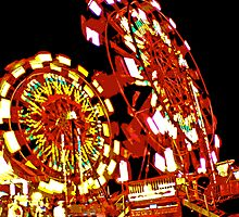 Two Ferris Wheels at Night by Bob Fox