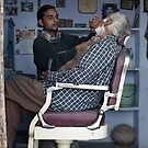 The Barber in Pushkar by Lisa Bow