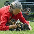 Cradling the Puppies by Bine