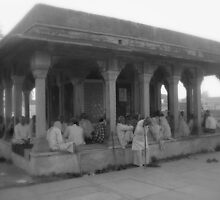 Old men spending their morning hours chatting away in a mausoleum by nisheedhi