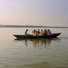 A boat of pilgrims on the river Ganga in Varanasi by nisheedhi