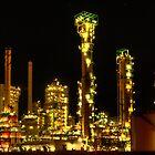 Esso refinery at night by Martijn Budding