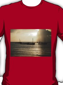 Dhow at sunrise on the ocean T-Shirt