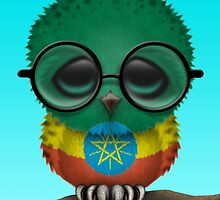 Nerdy Ethiopian Baby Owl on a Branch by Jeff Bartels