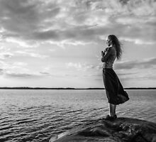 Woman looks at the horizon by JH-Image