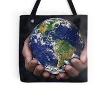 Holding the Earth Tote Bag