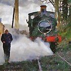 Engineer walking through steam from locomotive, East Somerset Railway, Shepton Mallet, UK by buttonpresser