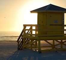 yellow guardhouse at sunset by yaxno3