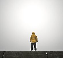 Person Wearing Rain Coat with Empty Space by Dan Jesperson